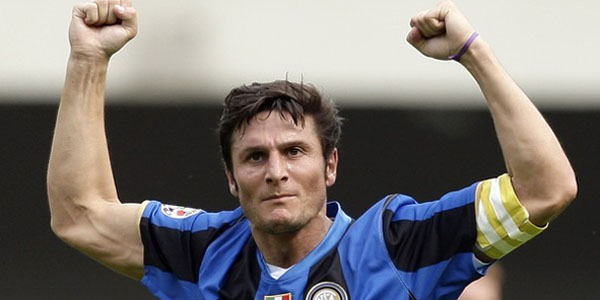 Inter Milan's Zanetti celebrates after a goal scored by his teammate Balotelli against Chievo during their Italian Serie A soccer match at the Bentegodi Stadium in Verona