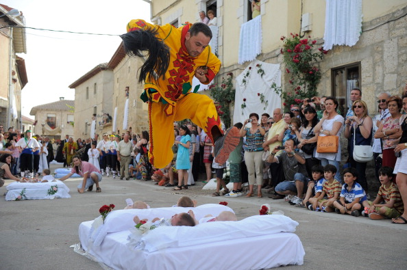 BURGOS, SPAIN - JUNE 26:  A man representing the devil leaps over babies during the festival of El Colacho on June 26, 2011 in Castrillo de Murcia near Burgos, Spain. The festival, held on the first Sunday after Corpus Cristi, represents the devil taking away original sin from the newly born babies by leaping over them.  (Photo by Denis Doyle/Getty Images)
